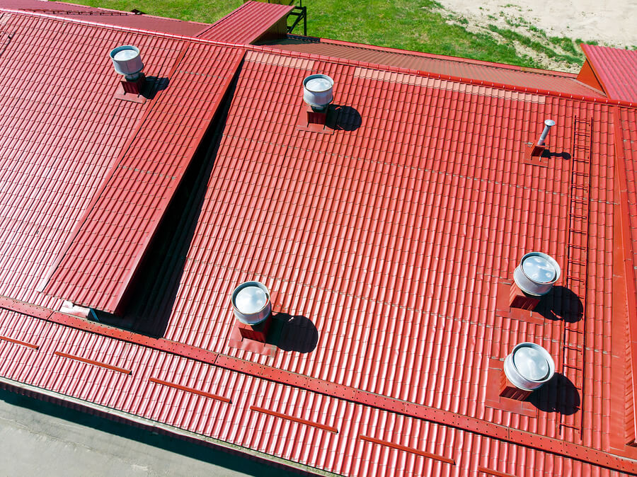 red metal roof with multiple air vents